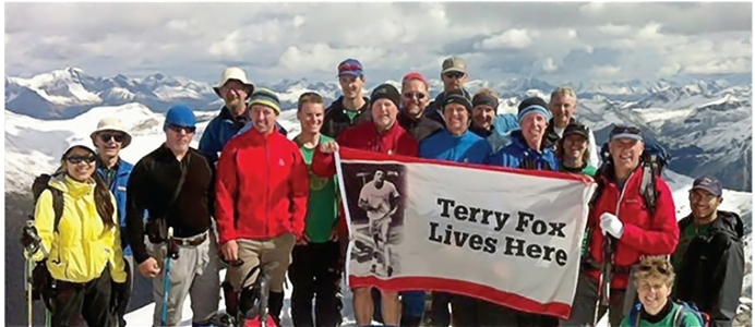 Group of hikers posing on top of Mt Terry Fox