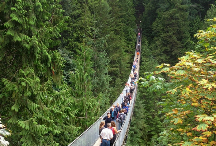 Lots of people on a suspension bridge in Vancouver